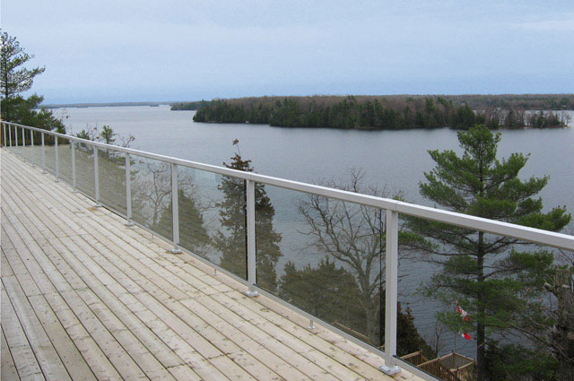 White-Large-Glass-Panel-Railing-on-Deck-by-Lakeside